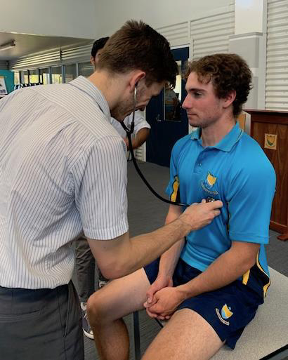 Dr Jett Nelson checking the vital signs of Luke Greatrex and our year 11 cohort with their presenters