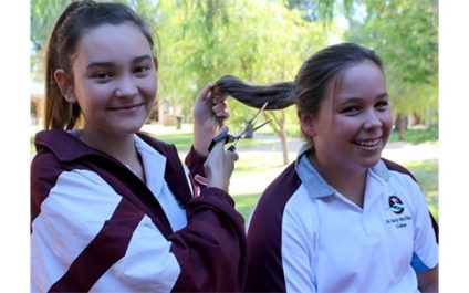 Girls lose locks for a cause