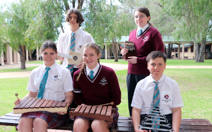 Year 8 students making music in Science