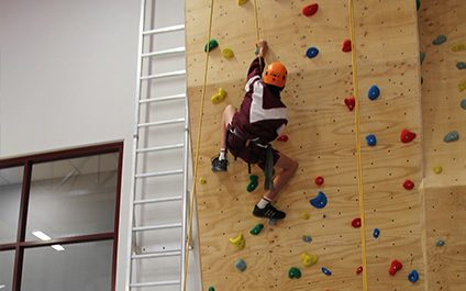 Climbing the wall in our new gym