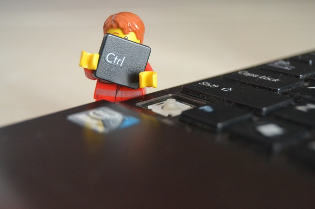 Lego man holding keyboard control key