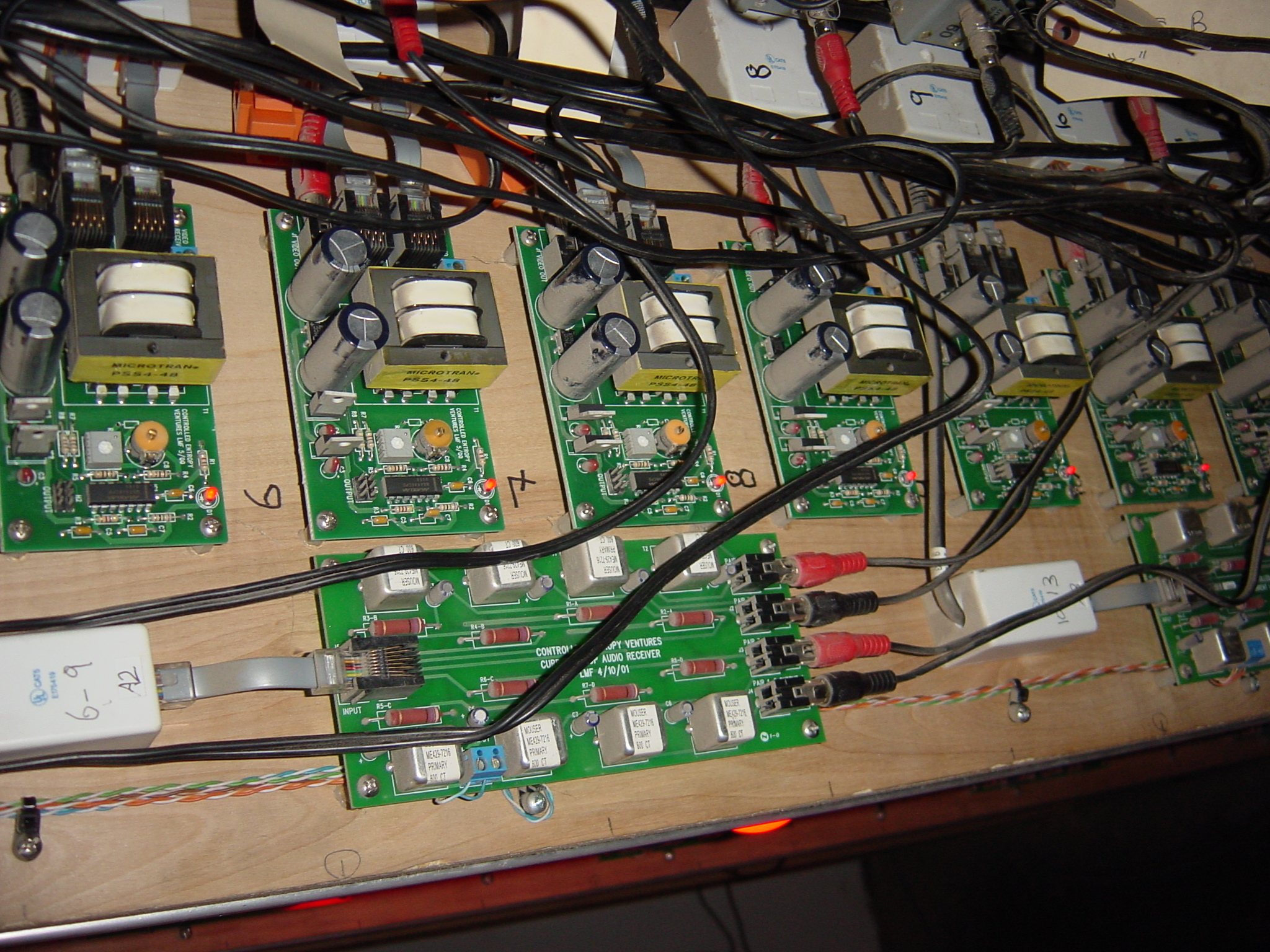 Custom designed boards move video, audio, and control signals over CAT-5 cables.