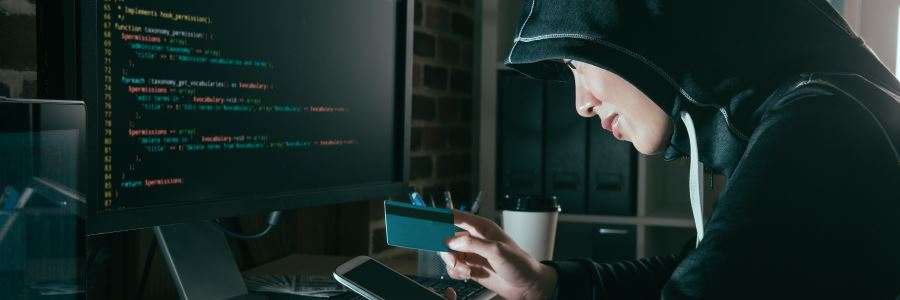 Hacker-Holding-Credit-Card-feature