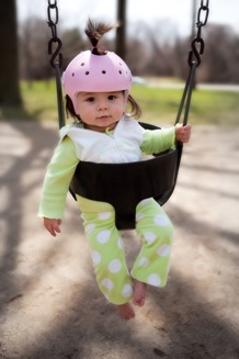 Baby-with-Helmet-on-Swing