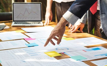 What are the business benefits of material requirement planning?