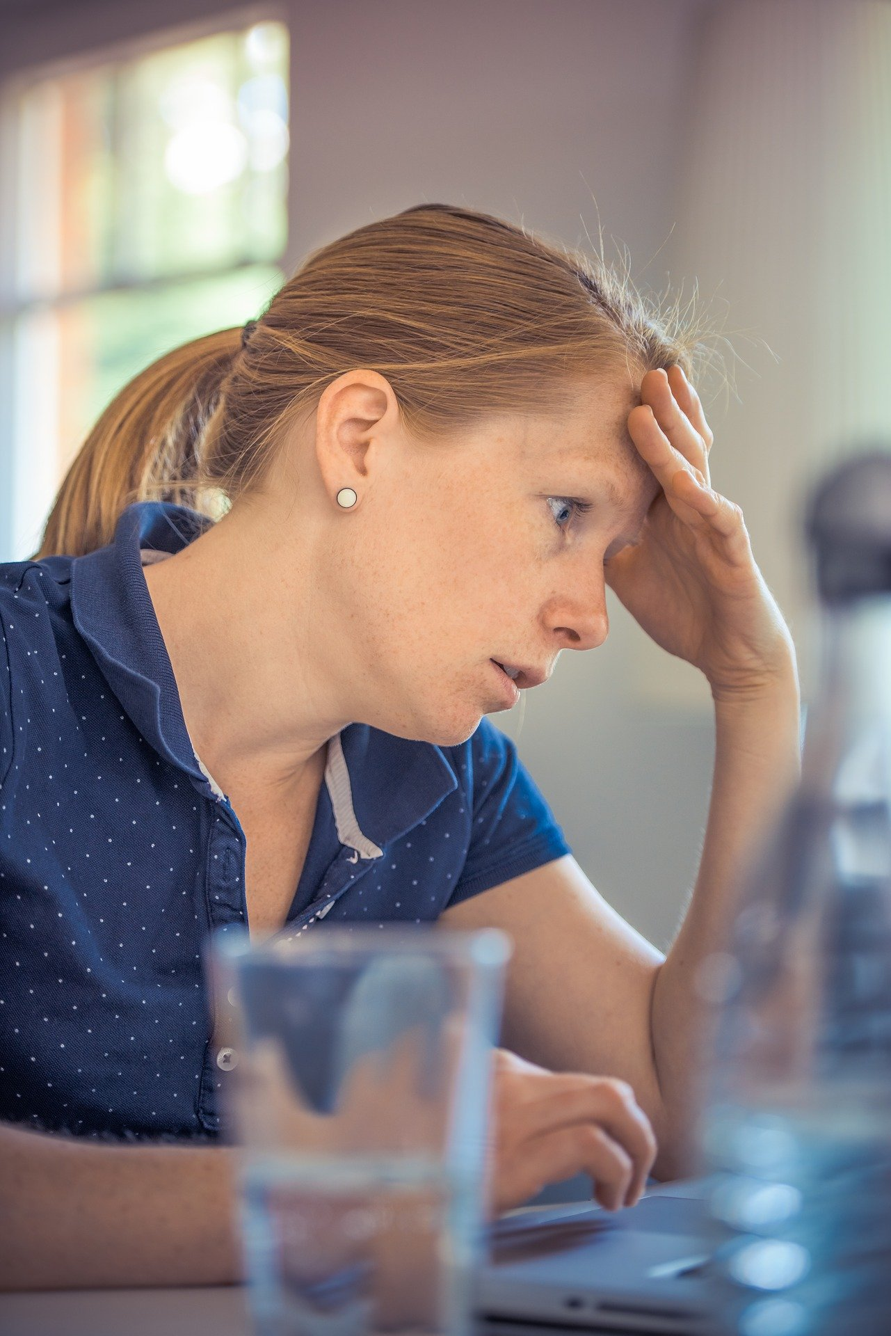 Adult female business owner stressed out