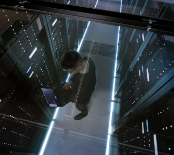a person standing in a data center