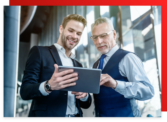 Two business men looking at the cloud on an iPad