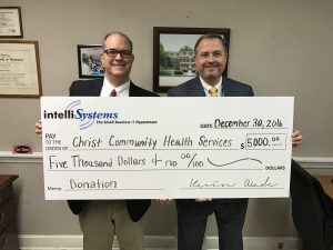 Kevin Wade, President and CEO of IntelliSystems, presents $5000 check to Jeff Drake of Christ Community Health Services of Augusta