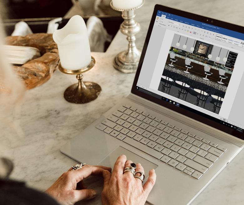 A laptop is open displaying Linda's mood board in Microsoft Word.