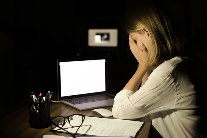 Woman dealing with Cyber security attack