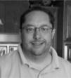 A headshot of Greg Welch, a BIS client