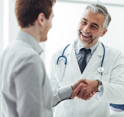 picture of doctor shaking patients hand - HIPAA & HITECH Compliance for Healthcare