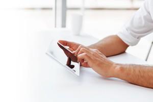 Man usign digital tablet at the desk