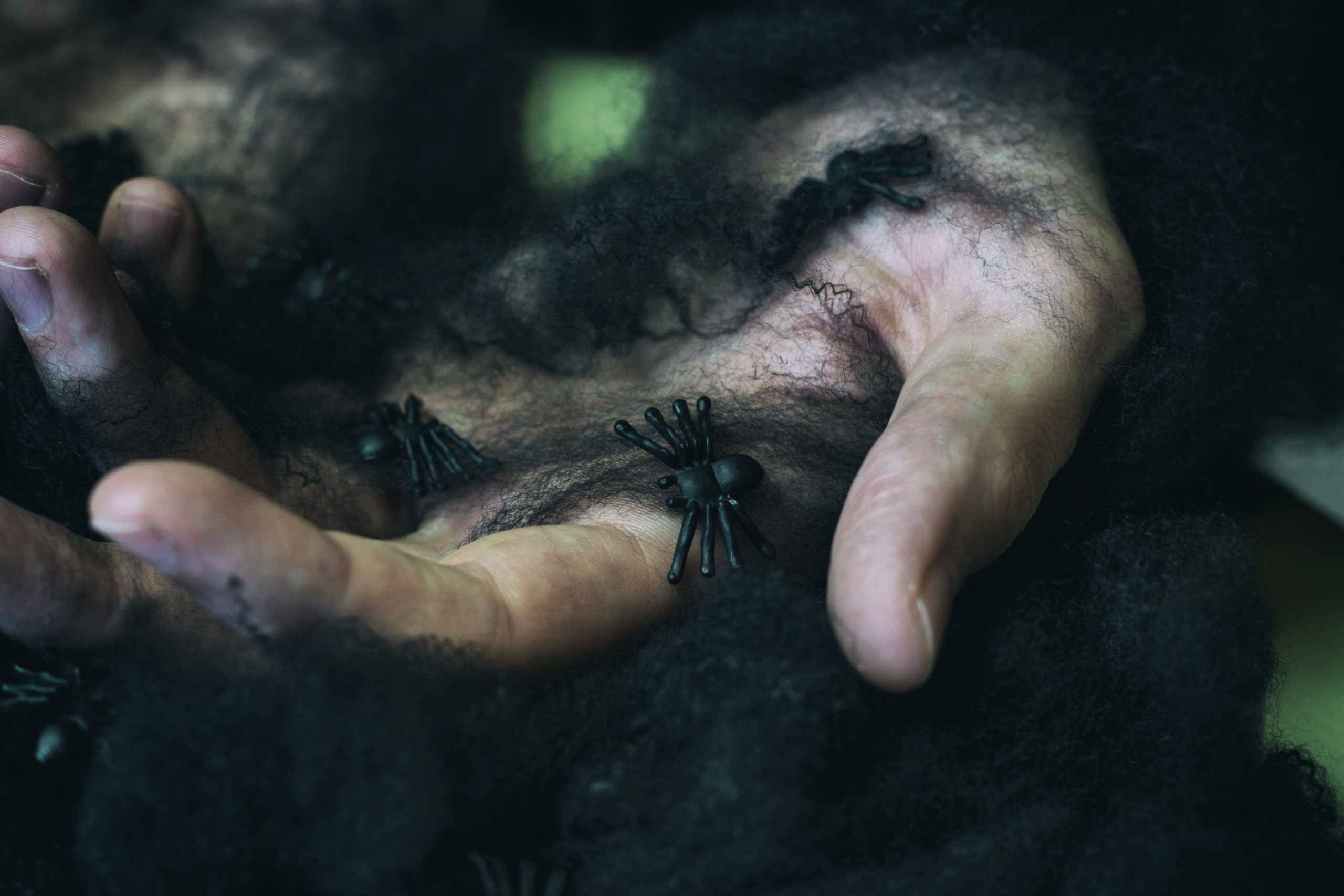 young-man-with-black-spider-web-in-his-hands-23LFB9Y-scaled